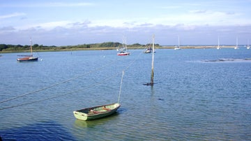 Boats moored in the sheltered estuary at Newtown on the Isle of Wight