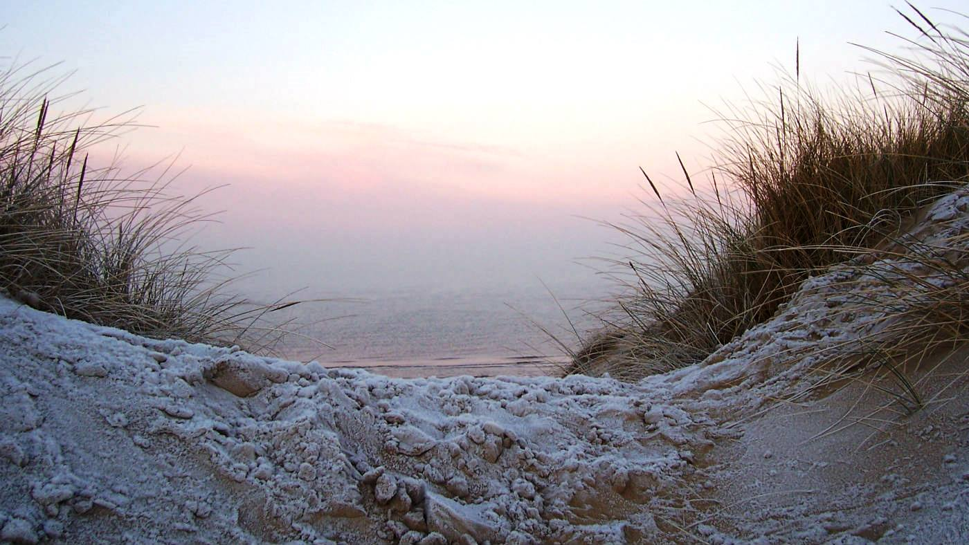 Frosty sand dunes during sunrise at Formby