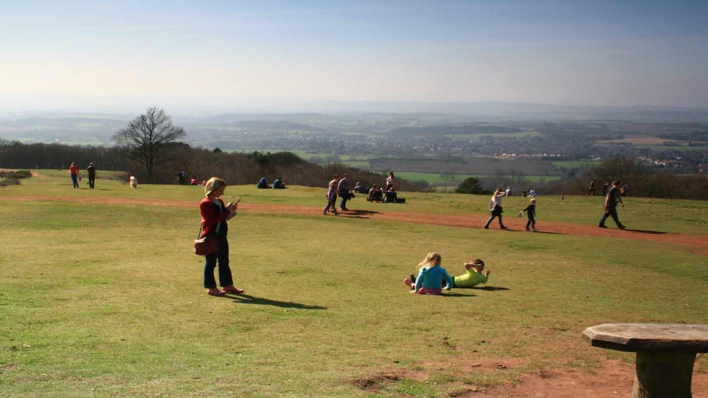 People relaxing and playing on the top of Clent Hill