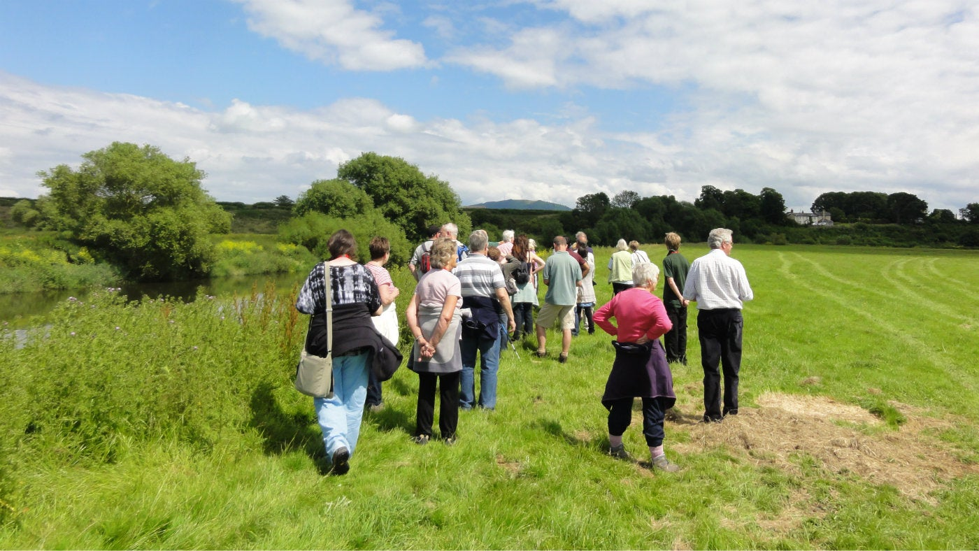 A summer's day as a guided tour takes visitors around the park at Attingham