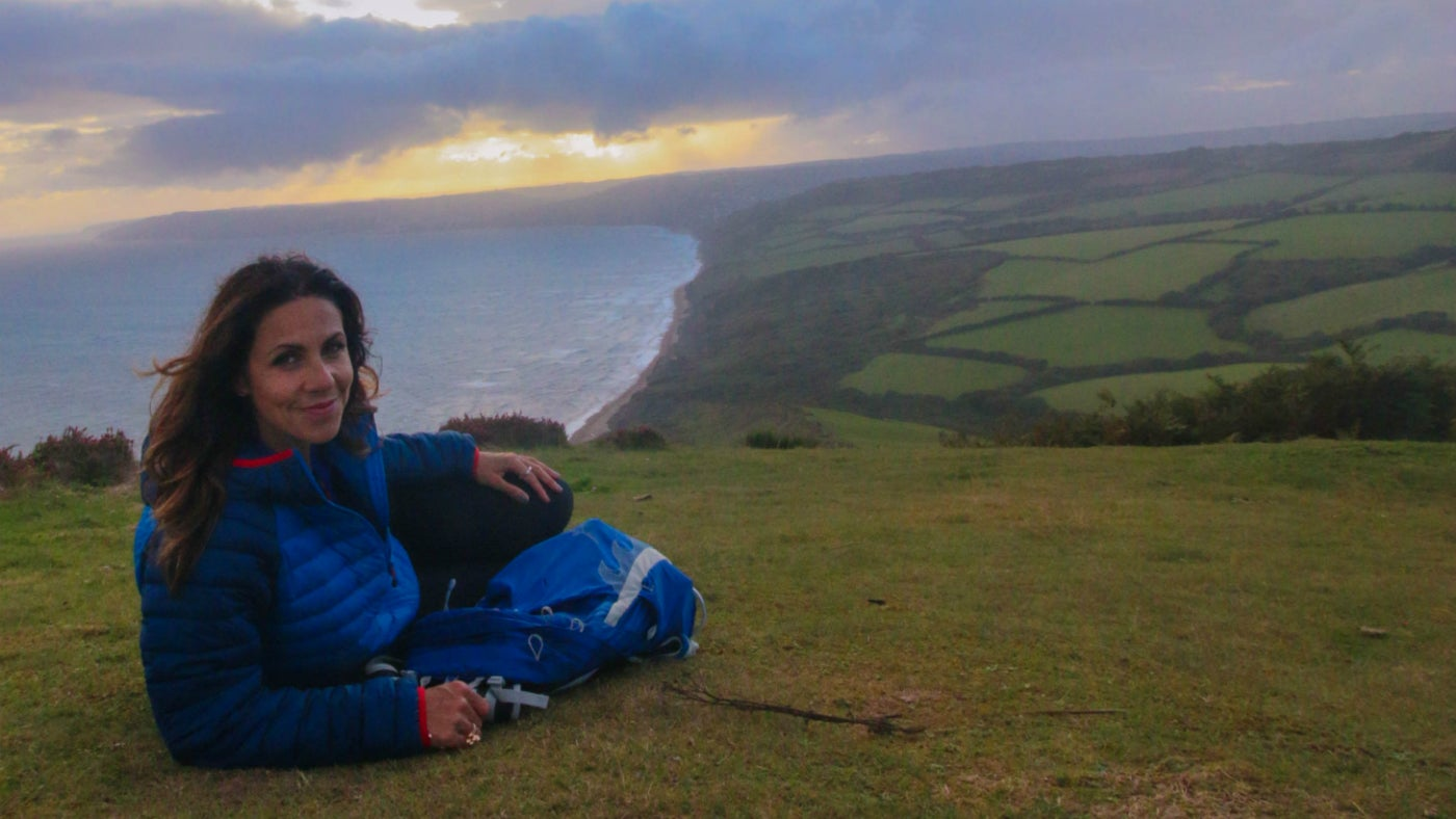 A still image from Julia Bradbury sitting on the western slope of Golden Cap in an episode from her TV series Best Walks with a View