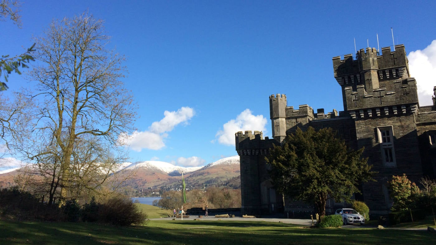 View of Wray Castle with snow capped hills, Ambleside, Cumbria