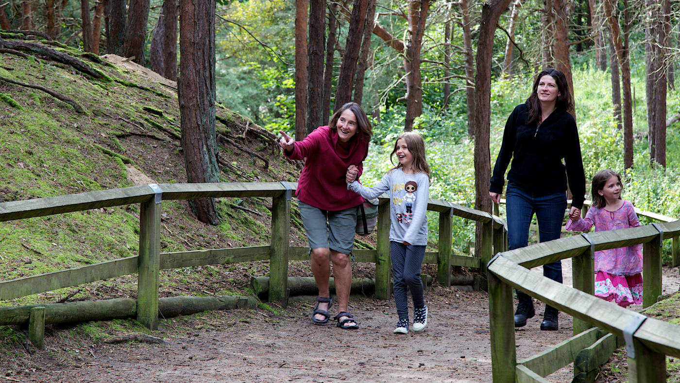 Family walking through the woods at Formby