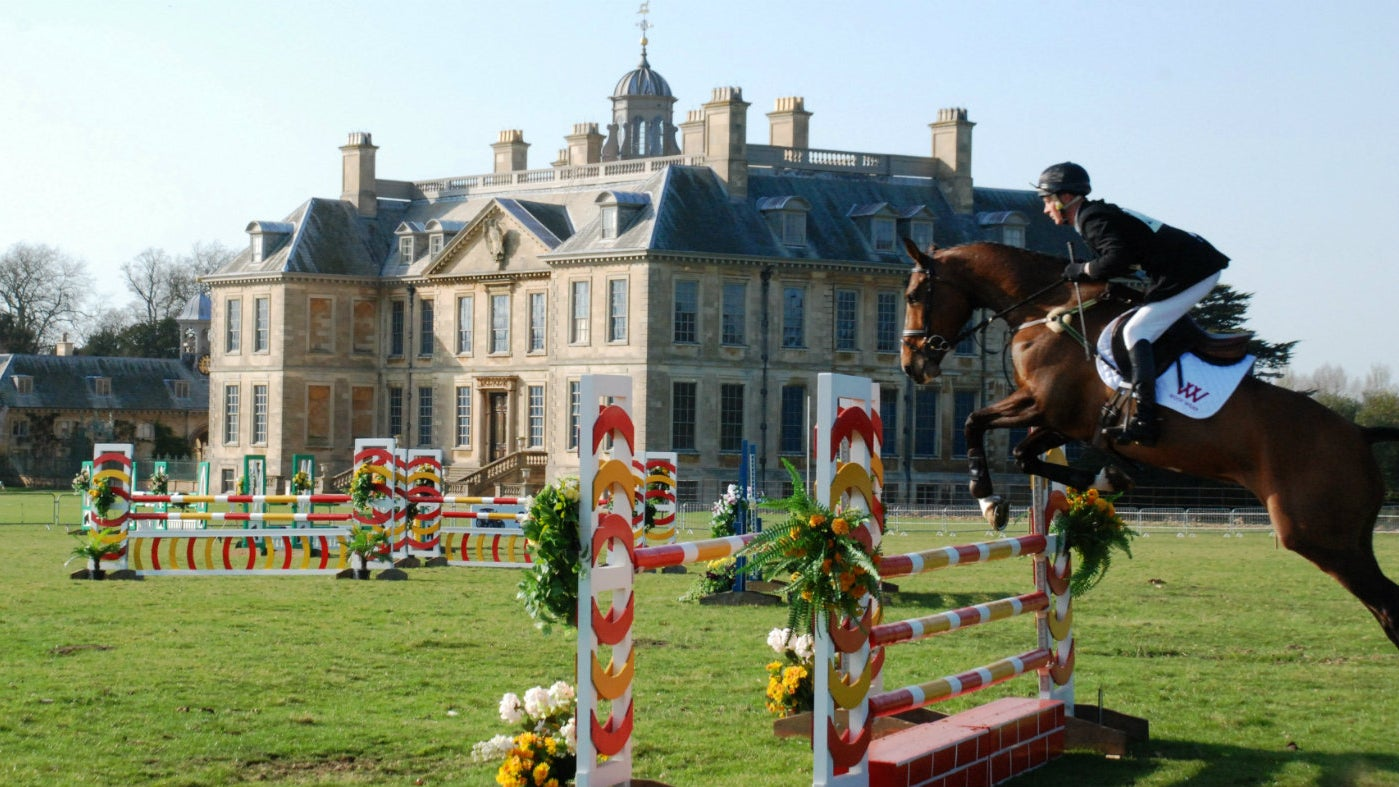 A leaping horse in front of Belton House