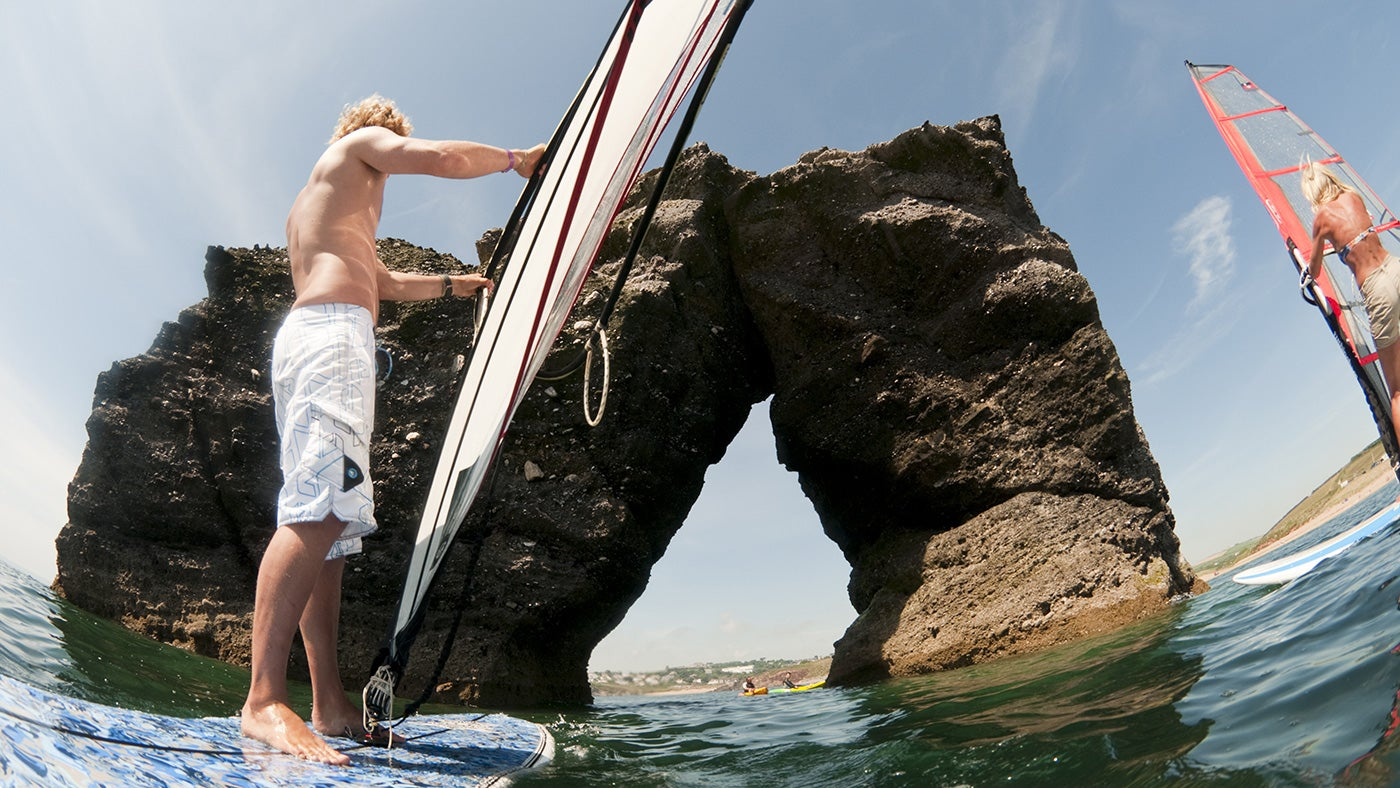 Watersports enthusiasts can try and windsurf through the arch of Thurlestone Rock