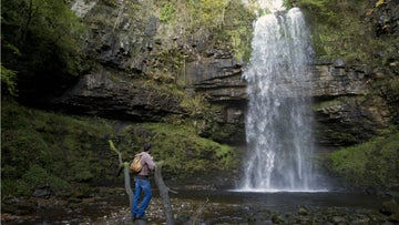 Visitor at Henrhyd Falls, Powys, Wales