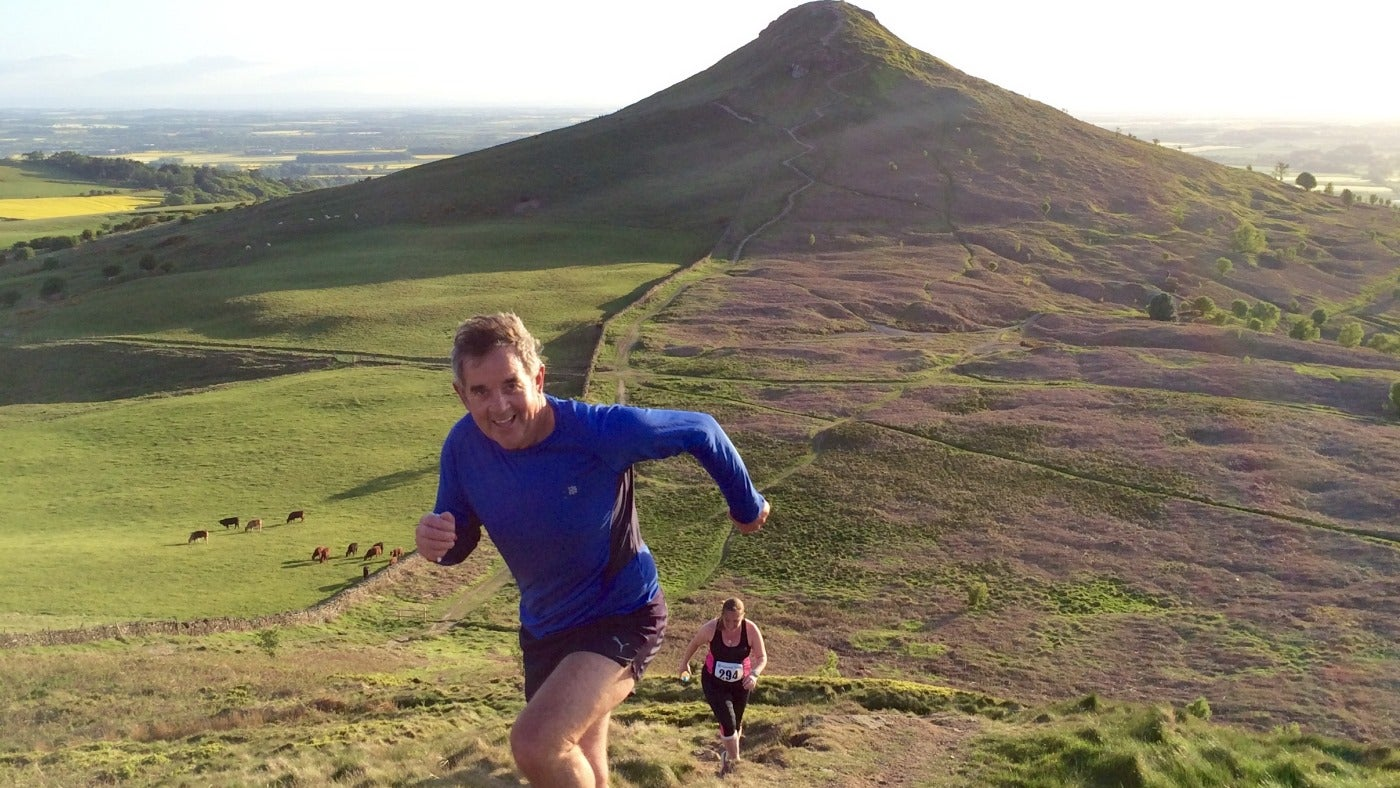 Runners with Roseberry Topping behind them