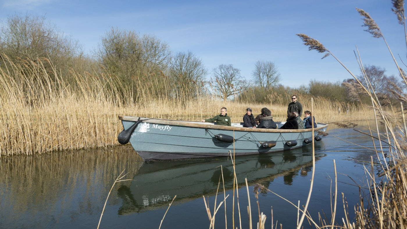 A group of visitors on a boat trip at Wicken Fen