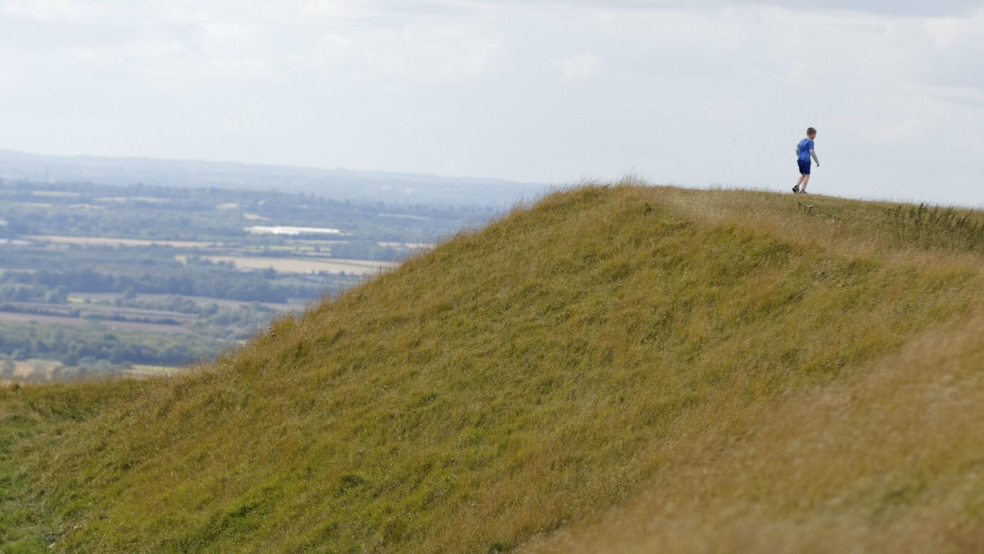Child walking on iron age earthworks at White Horse Hill, Uffington Oxfordshire