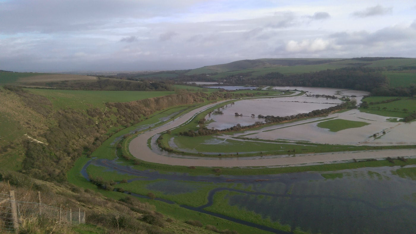 This is a view of the Cuckmere Valley in flood as seen from the Litlington Whitehorse