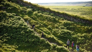 A group walking along Hadrian's Wall