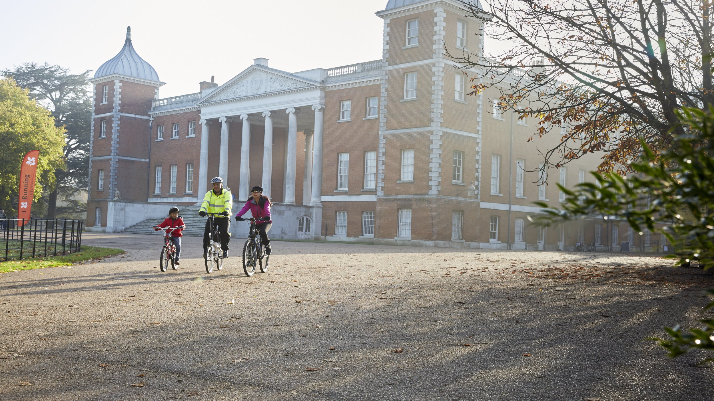 Family cycling at Osterley