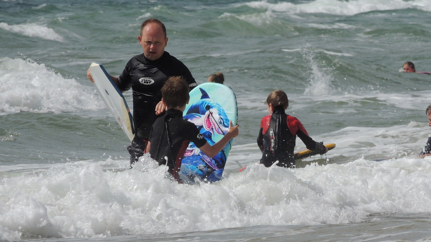 Family bodyboarding at Compton Bay, Isle of Wight