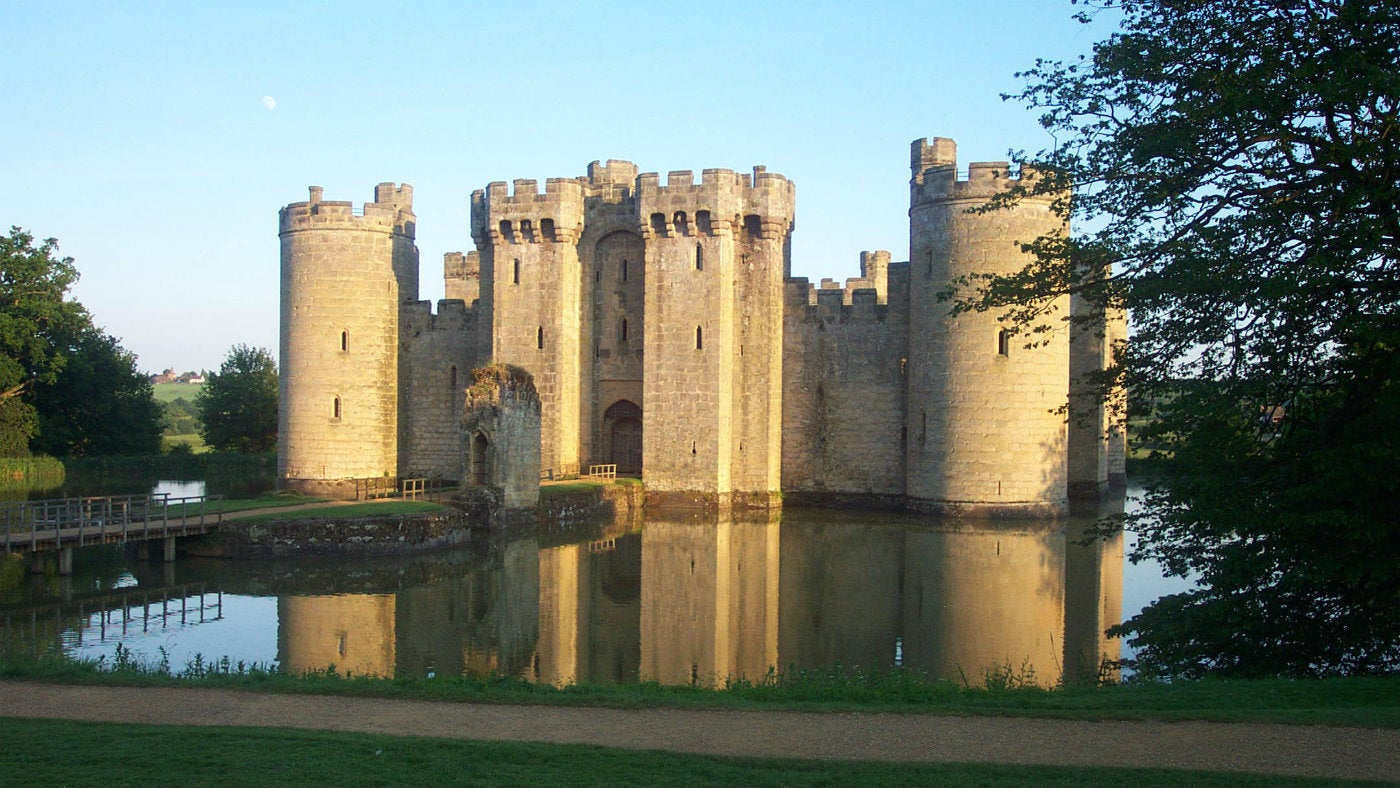 A view across the moat to Bodiam Castle in the early morning sunshine