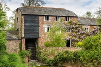 Clyston Mill is nestled by the River Clyst.