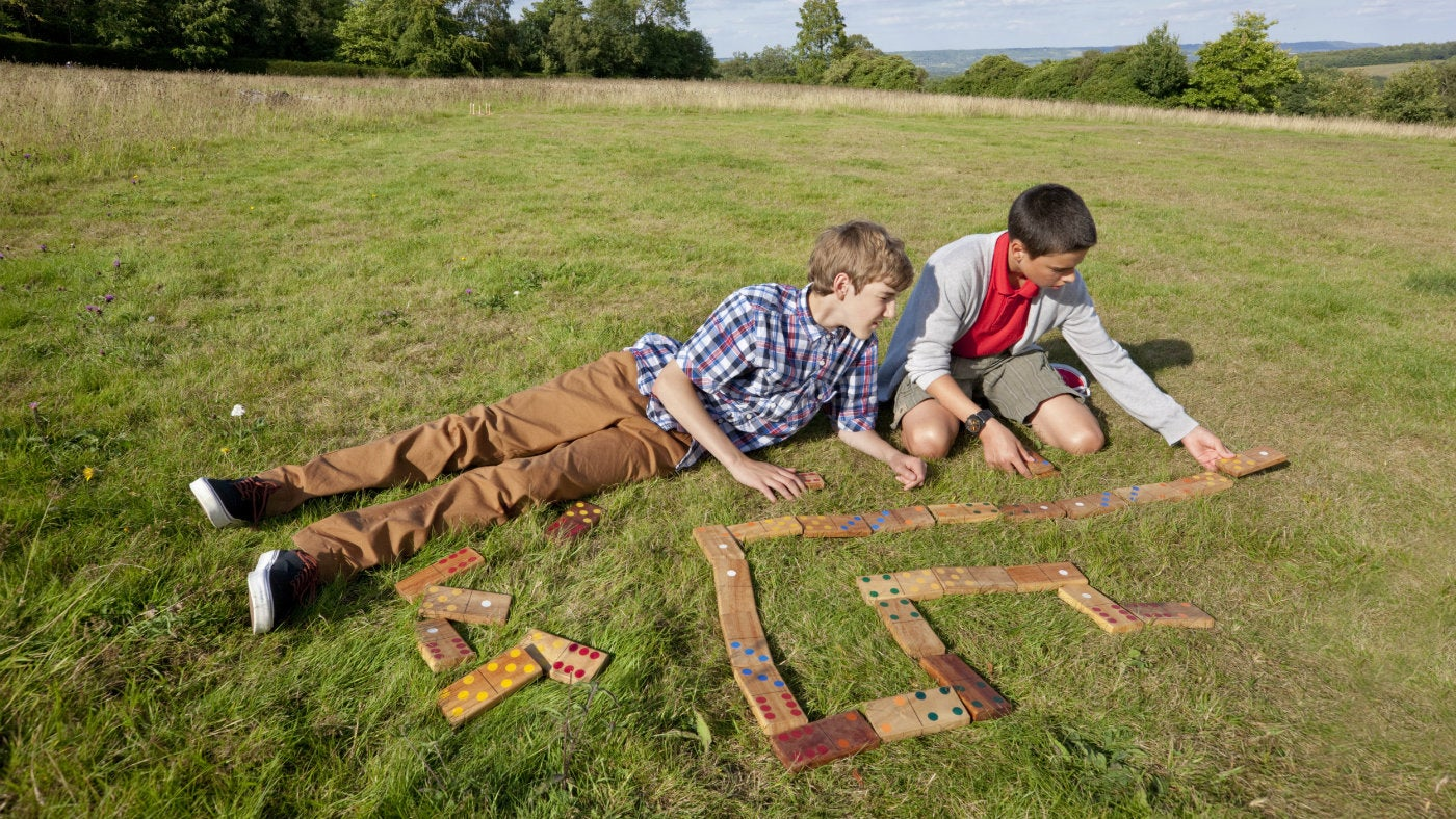 A family plays giant dominoes at Emmetts Garden, a National Trust property in Kent