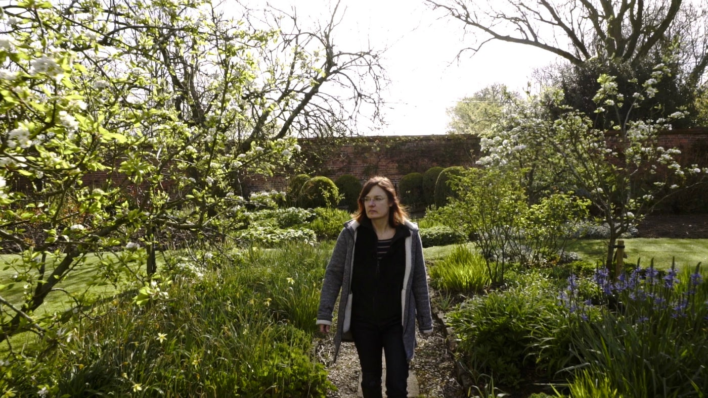 Artist Christiane Löhr walking in the Gunby gardens
