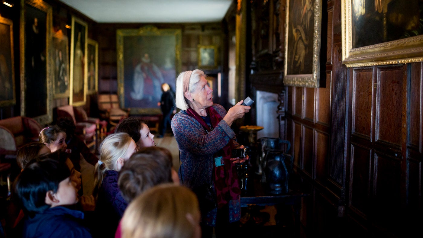 A volunteer shares her knowledge in the showrooms at Knole