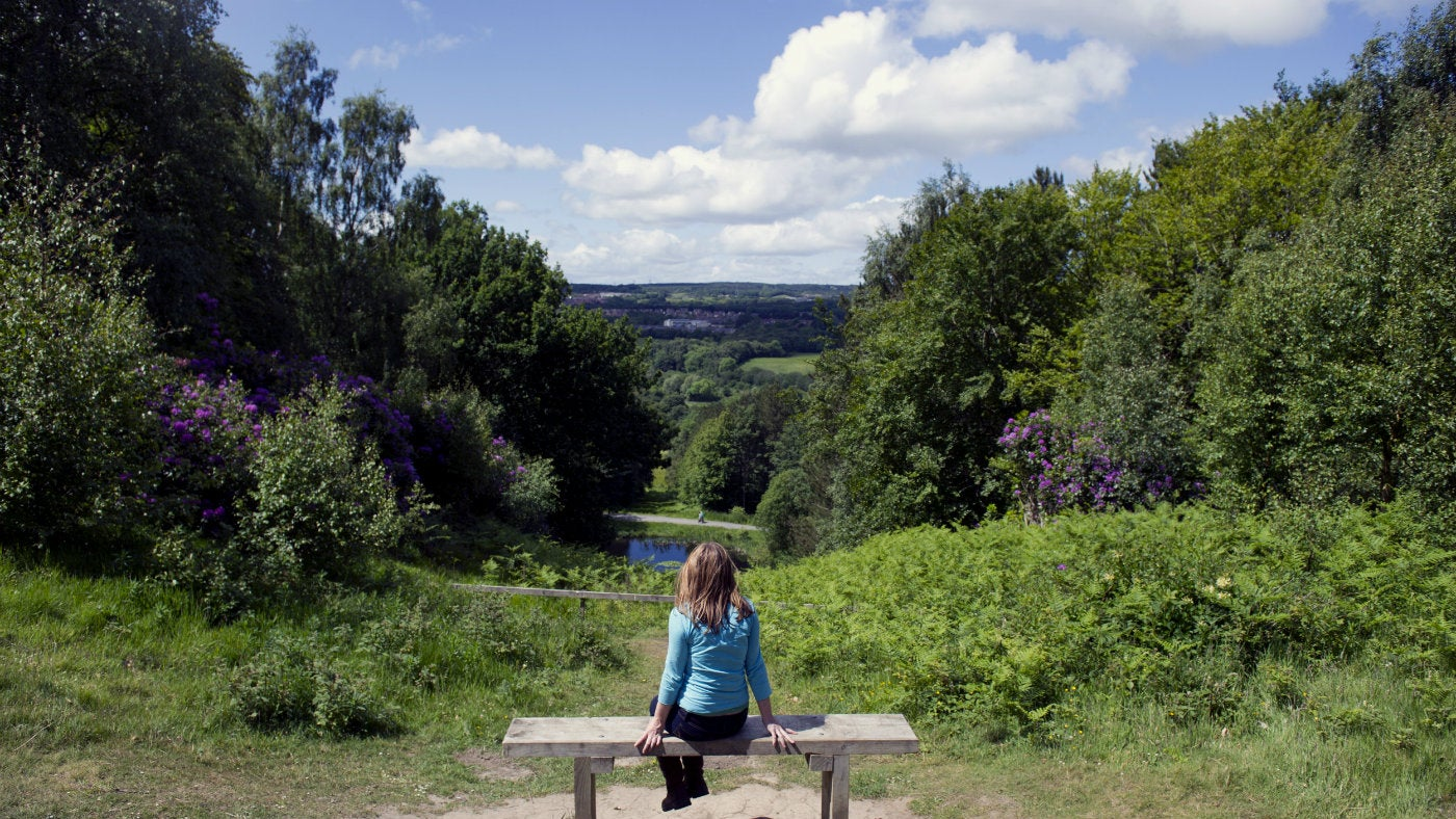 A woman sitting looking at the views