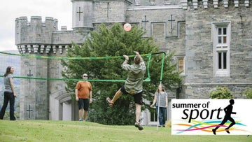 People playing volleyball at Wray Castle, Cumbria