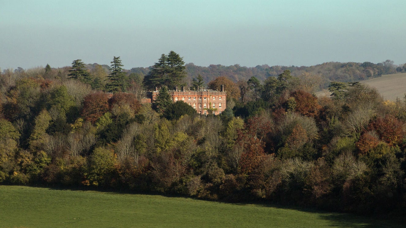 Distance view of Hughenden set in Autumn trees