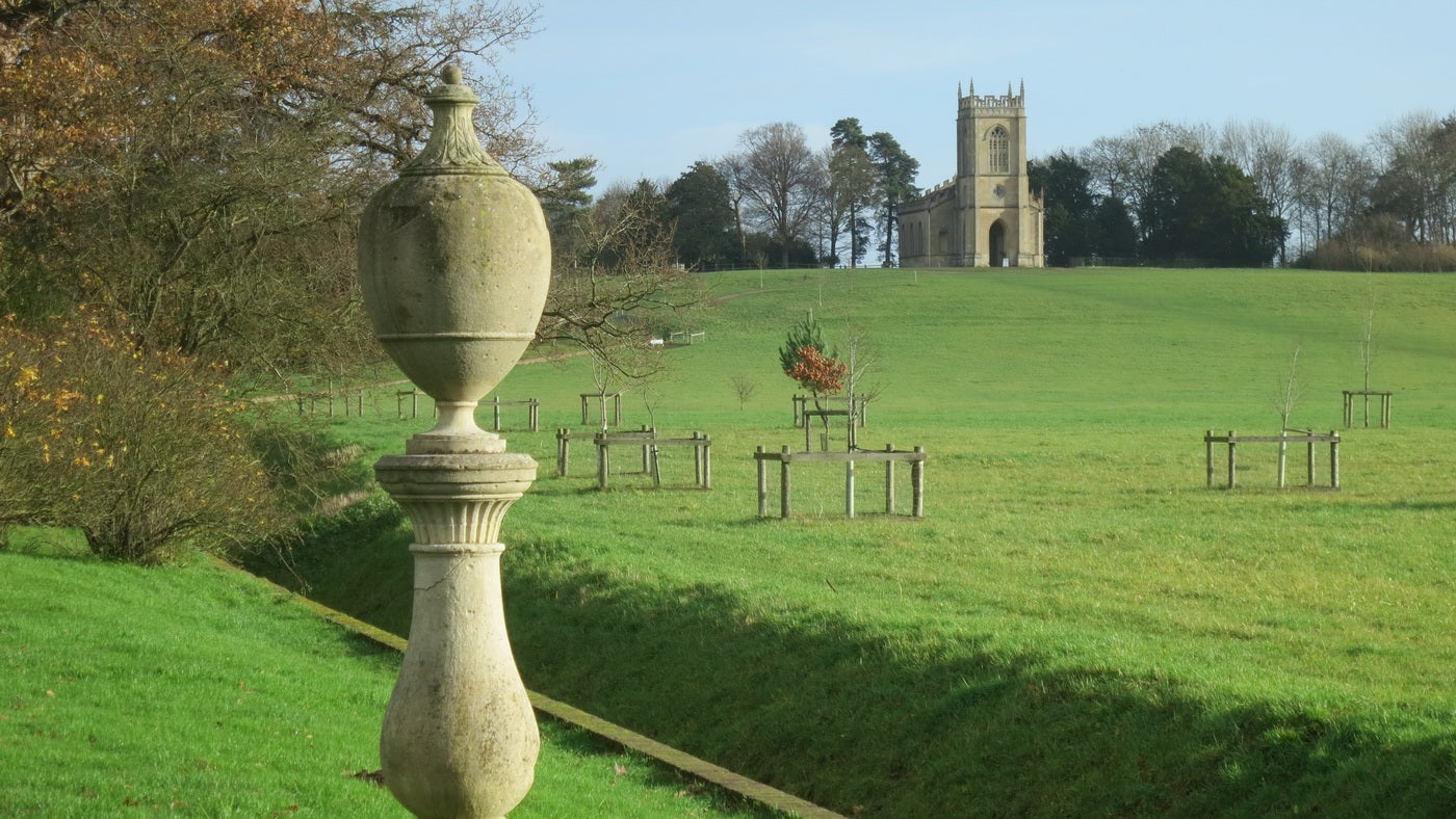 Croome stone urn and church