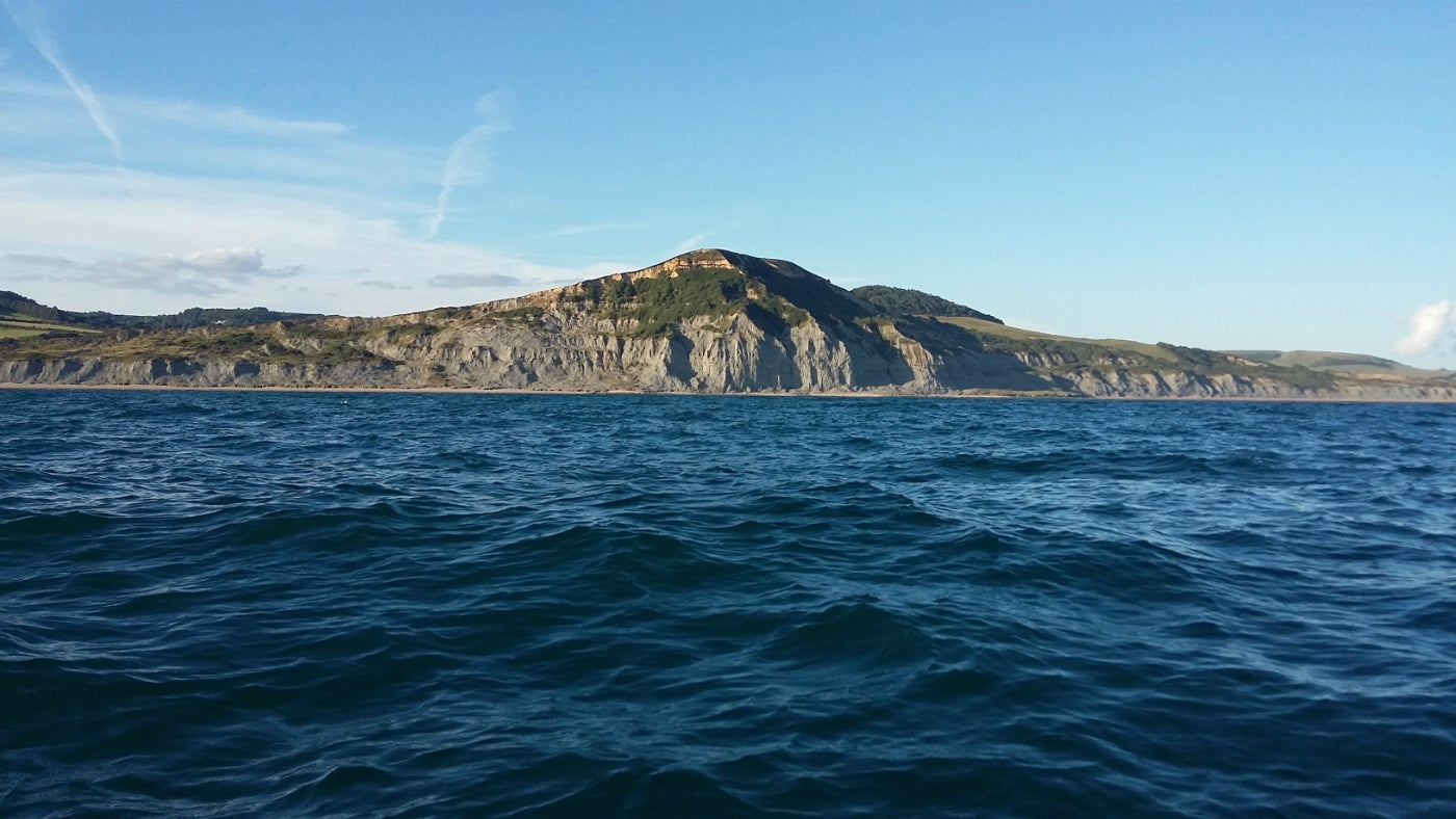 Golden Cap seen from the sea on a sunny evening in August