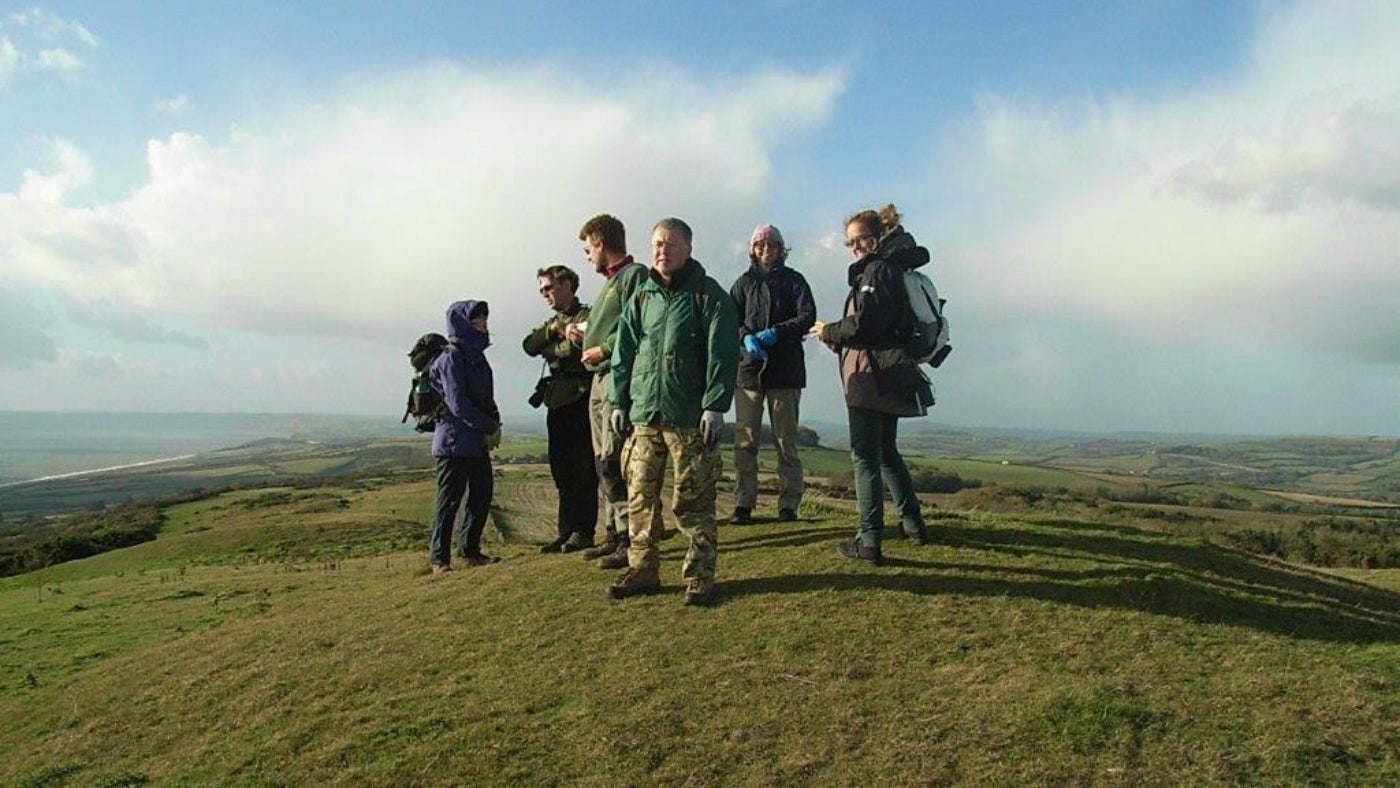 A group of walkers in the fields above Cogden and Burton Bradstock