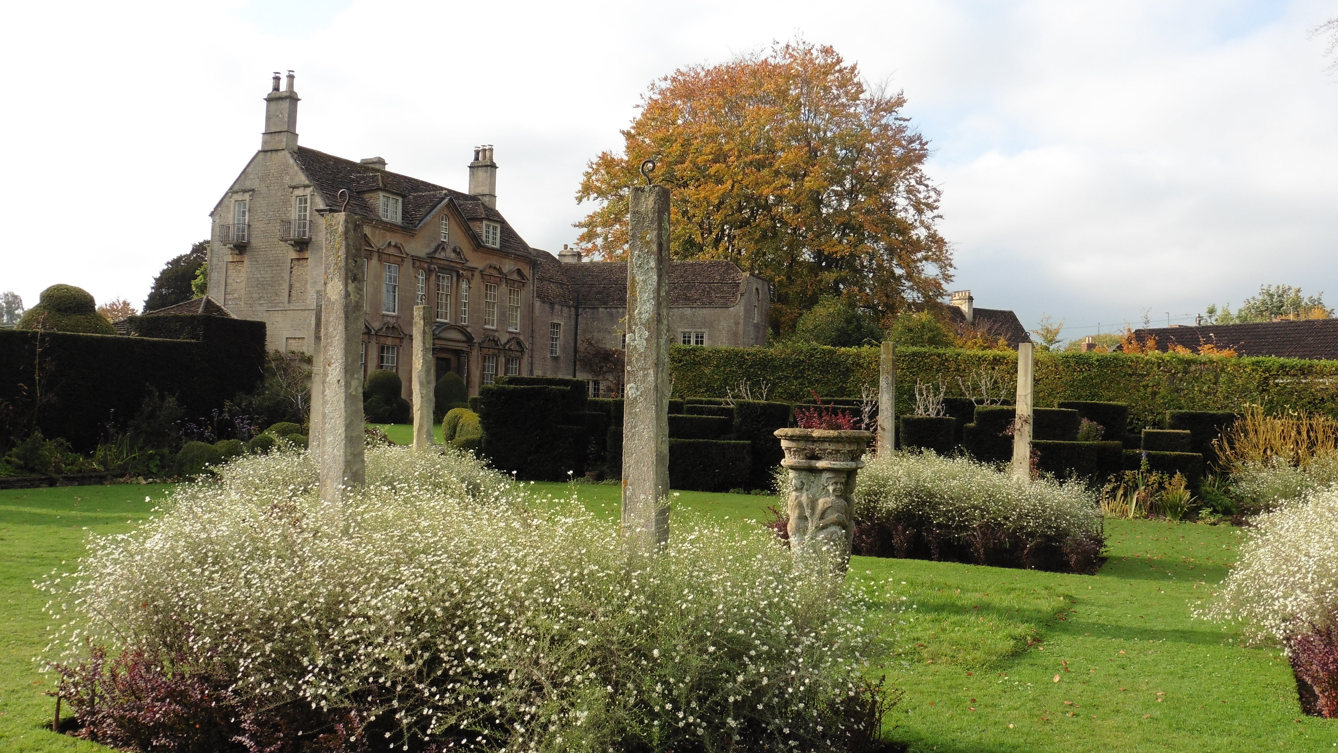 A view of the Pillar Lawn at The Courts garden, Holt in autumn.
