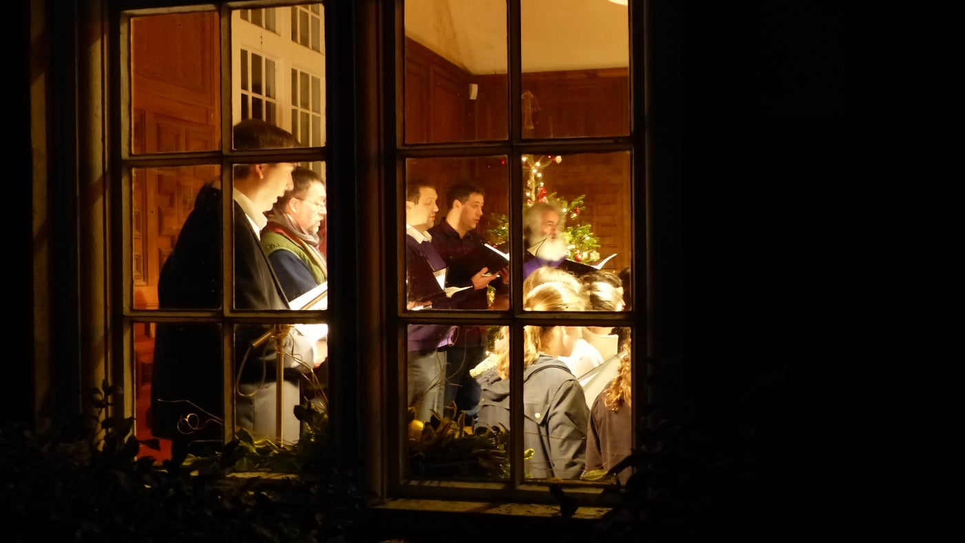 Carols singers in Oak Hall at Sheffield Park, East Sussex