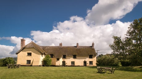 The exterior of Broad Ley Cottage, Longmeadow Cottage and Mattress Cottage, Broadclyst, Devon