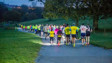 Runnners at night at Saltram