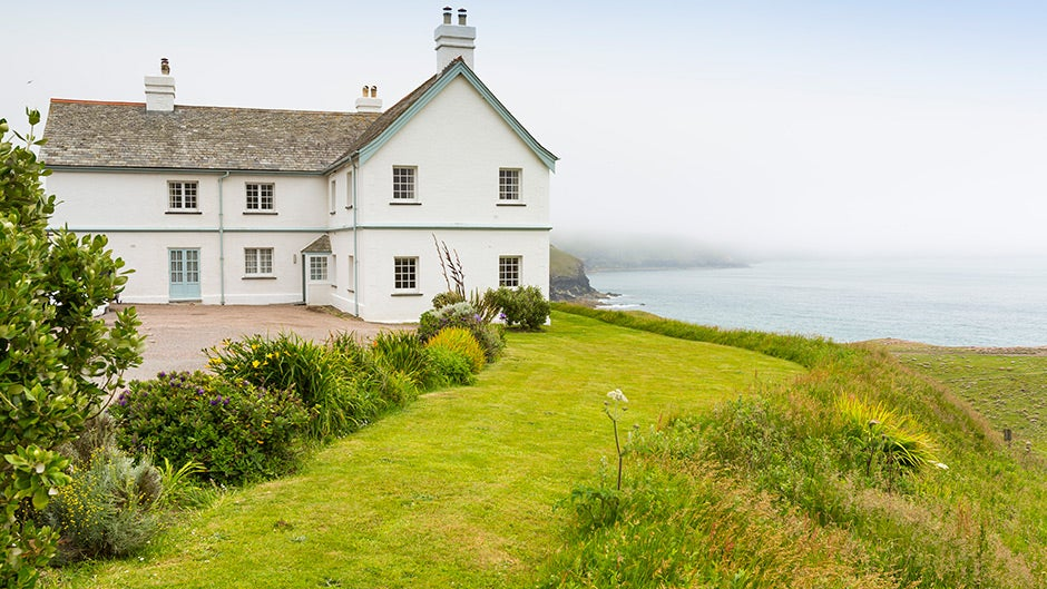 The exterior of Doyden House, which houses the Rumps, Carnweather, Mouls and Conor apartments, Port Isaac, Cornwall