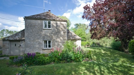 The stone exterior view of Lock Cottage, Buscot, Oxfordshire