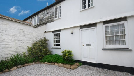The exterior of The White Cottage, Port Gaverne, Cornwall