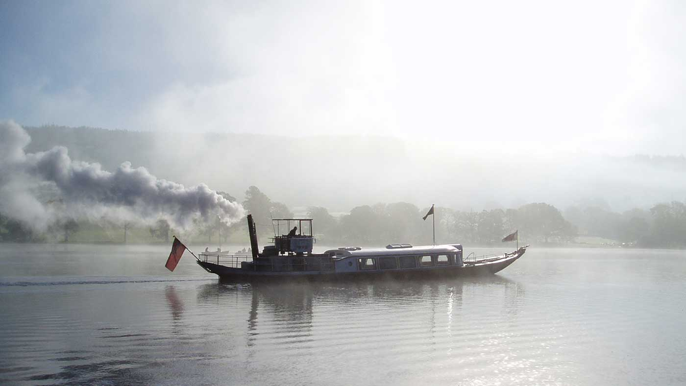 Gondola steaming across Coniston Water