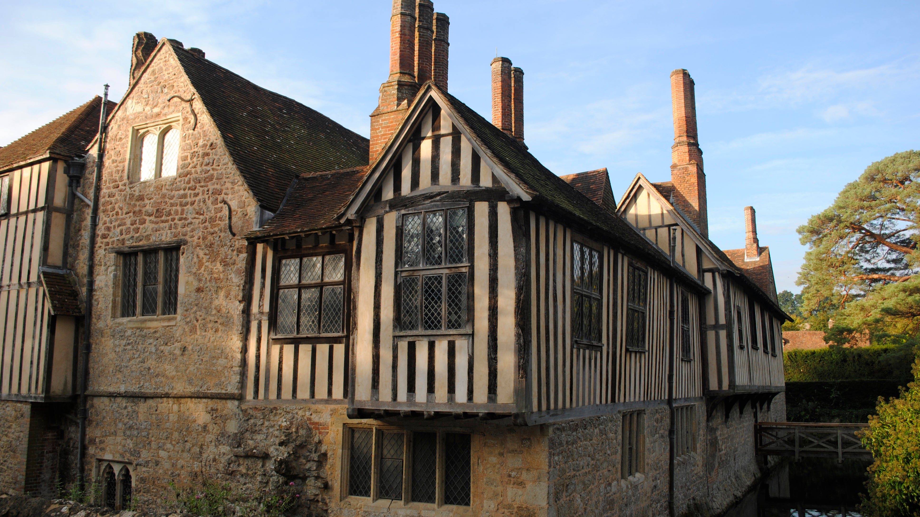 The north-east corner of Ightham Mote glows in autumn sunlight