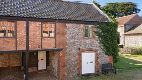 The brick exterior of 2 Cart Lodge Barn, Upper Sheringham, Norfolk
