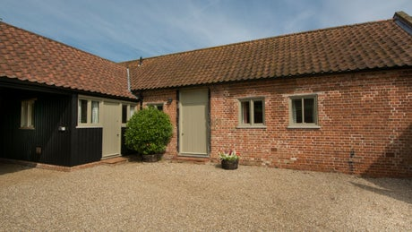 The brick exterior of Mill Farm Barn, nr Aylsham, Norfolk