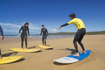 A group learning to surf