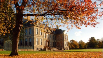 Belton House with autumn leaves