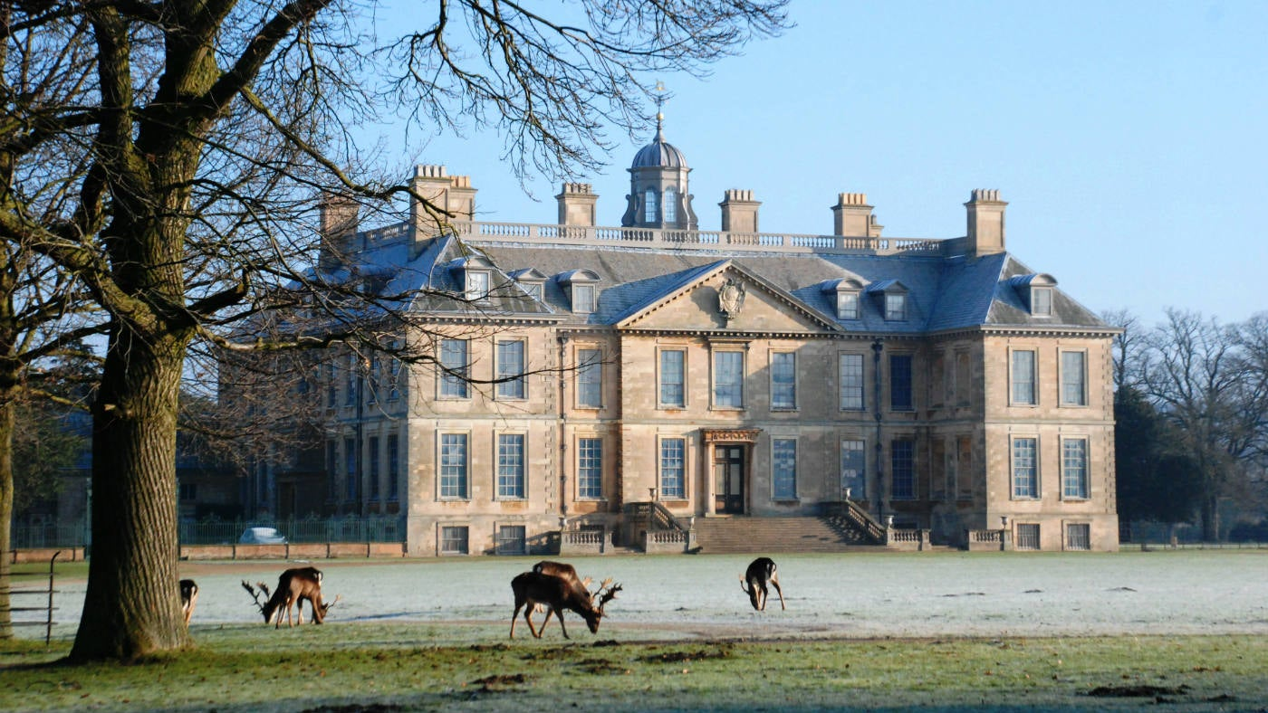 Belton House on a frosty morning with deer