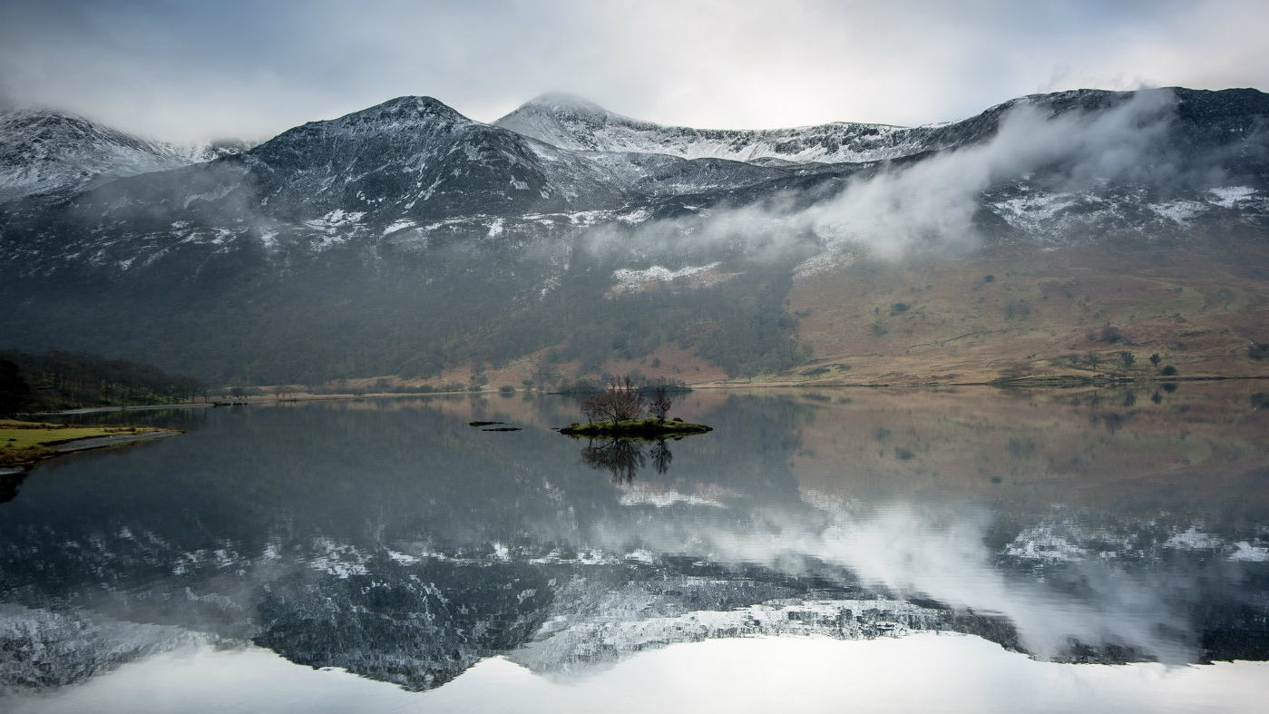Fells and lake in winter at Crummock, Lake District