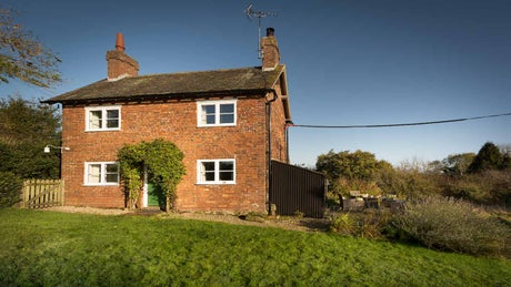 The brick exterior of Wicket Nook Cottage, Ashby de la Zouche, Leicestershire