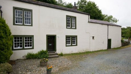 The whitewashed exterior of Watergate Farm, nr Cockermouth, Lake District, Cumbria