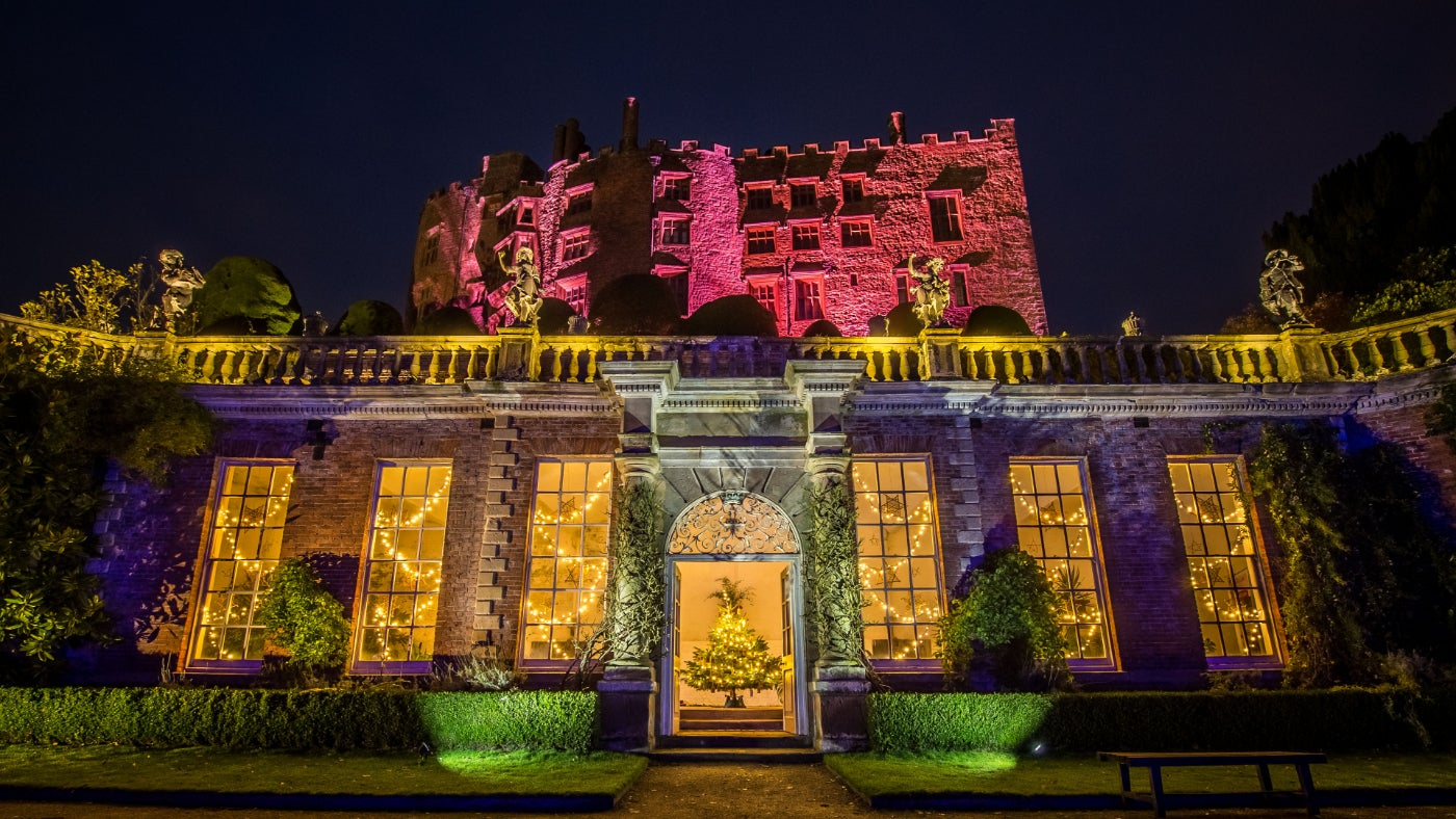 The Orangery illuminated for Christmas at Powis Castle and garden, Wales.