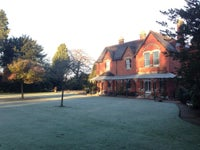 View of Sunnycroft from the main lawn with frost on the ground