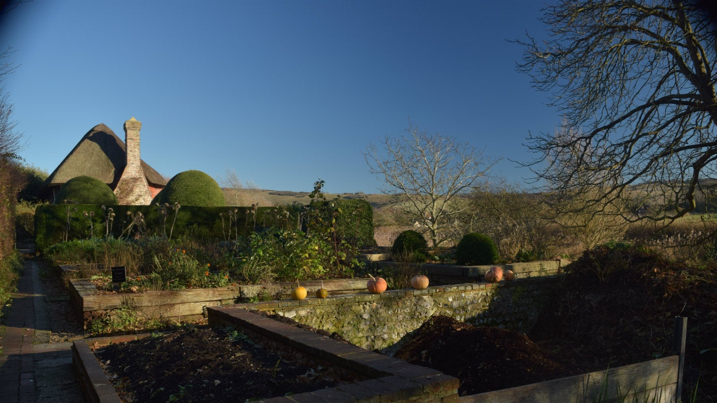 Alfriston Clergy House East Sussex view of house and vegetable garden in winter
