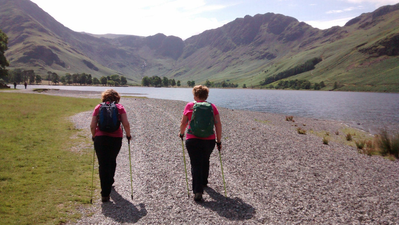 Two walkers learning how to do Nordic walking