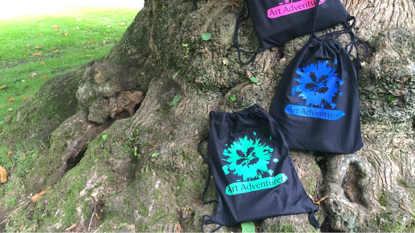 Art Adventurer backpacks resting on a tree at Petworth